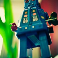 Robot standing in front of of a blurred backdrop