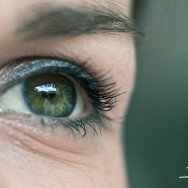 An macro of an eye, with a blured green backdrop