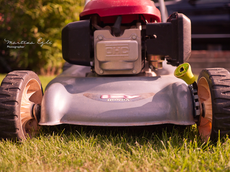 A close up of a lawn mower in the golden hour.
