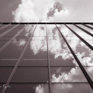 Red Image of clouds reflected in a glass building