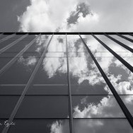 Image of clouds reflected in a glass building