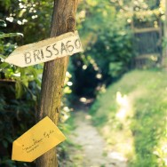 A signpost showing the direction to Brissago, a village in the Italian part of Switzerland.