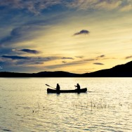 Two people in a canoe in Loch Lomond.