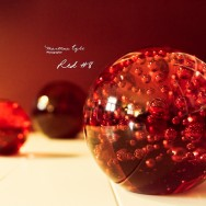 Three spheres made out of red glass.