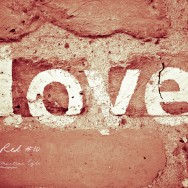 The words love painted onto a wall.