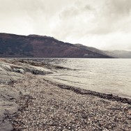 A shingle beach on Loch Lomond in Scotland.