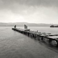 A jetty over Loch Lomond in stormy weather.
