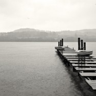 A jetty over Loch Lomond in storymy weather.