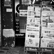 A newspaper stand filled with newspapers from all over the world.