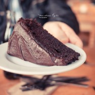 A yummy chocolate cake on a plate.
