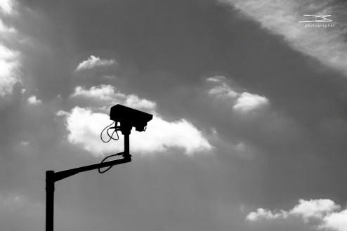 A silhouette of a cctv camera