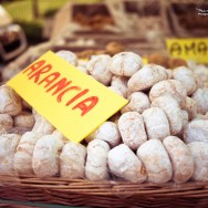 A basket of amaretti at a farmers market.