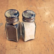 Salt and pepper shaker on a wooden table.