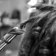 A woman has her curled in preparation for her wedding.