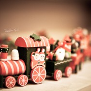 A wooden toy train with Santa Claus.