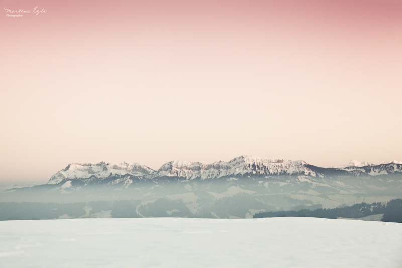 Pilatus and the Alps in winter at sunset.