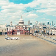 Skyline of London with St. Paul's Cathedral and Millenium Bridge.