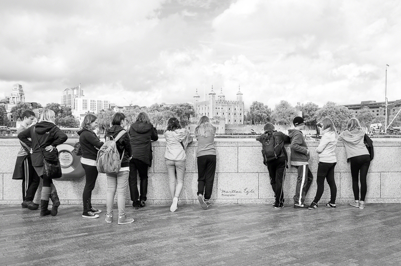 A group of teenagers looking at the Tower of London.
