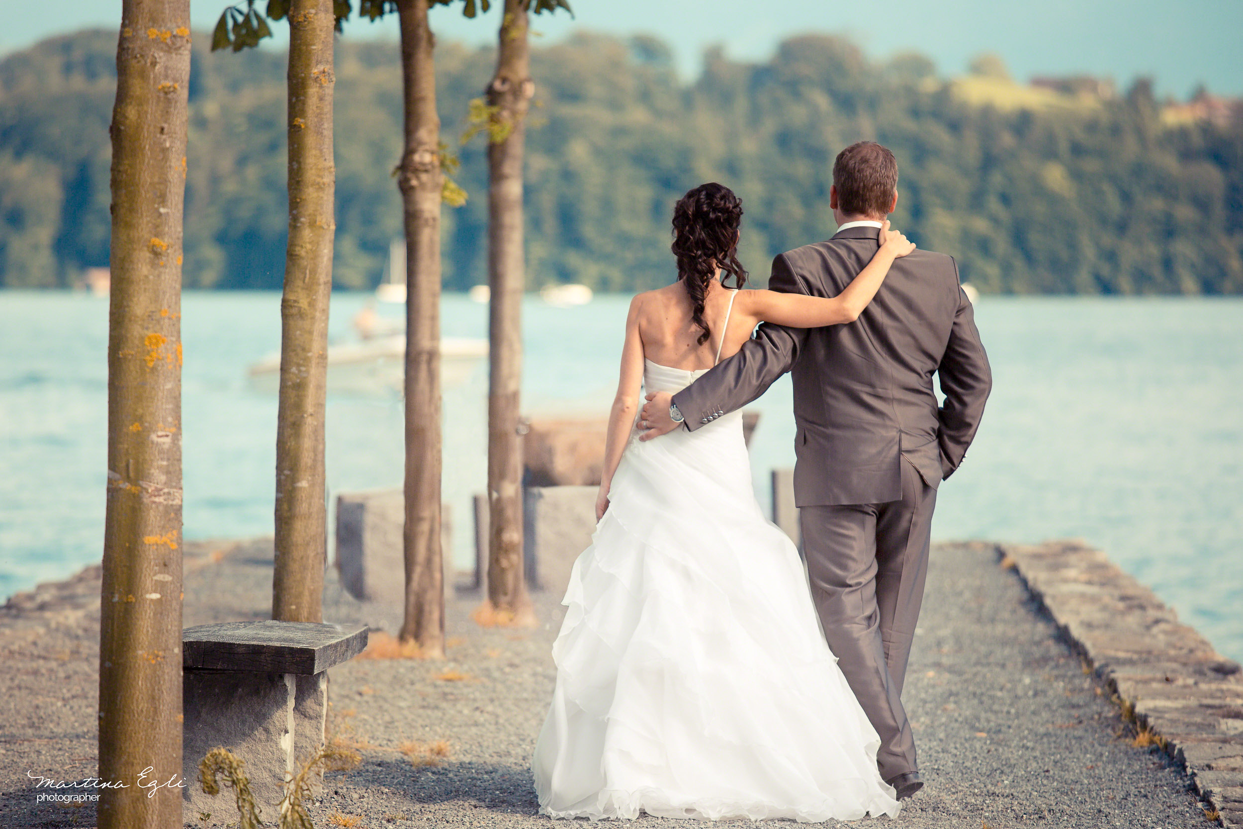 A Bride and Groom walk arm in arm