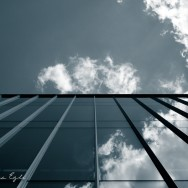 Blue Image of clouds reflected in a glass building
