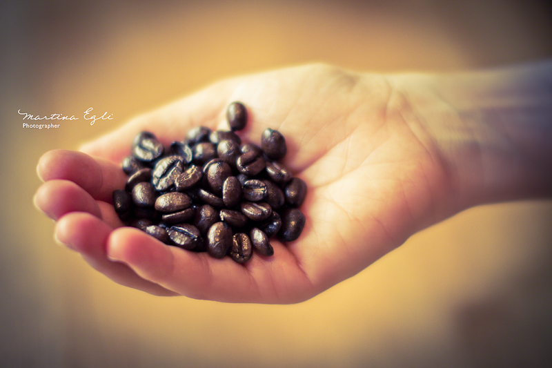 A handfull of coffee beans.