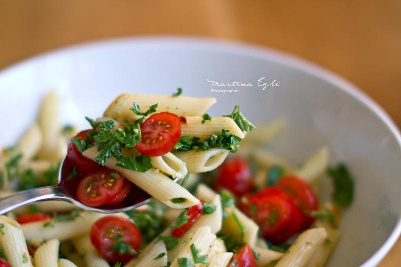A spoon full of Caprese pasta