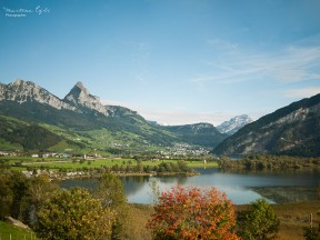 An autumny landscape with the Lauerzer See and the Swiss alps.