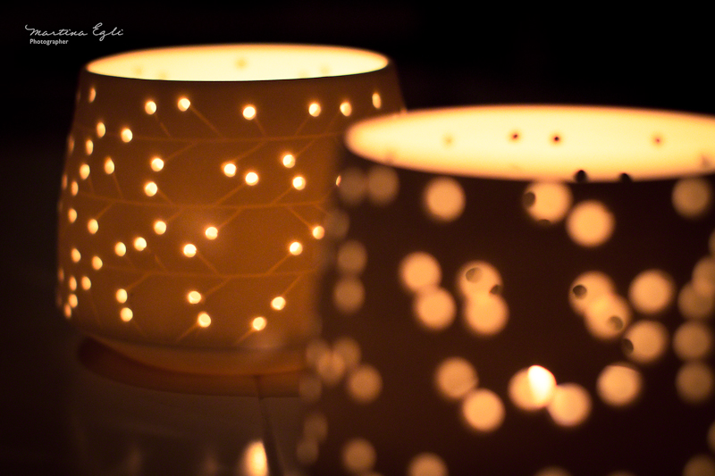 Candle holders illuminated from within.