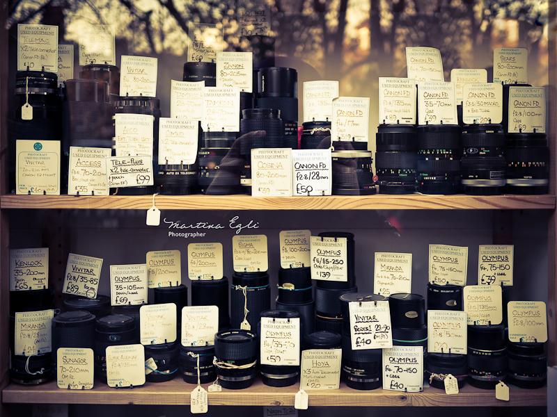 A window display of a camera shop.