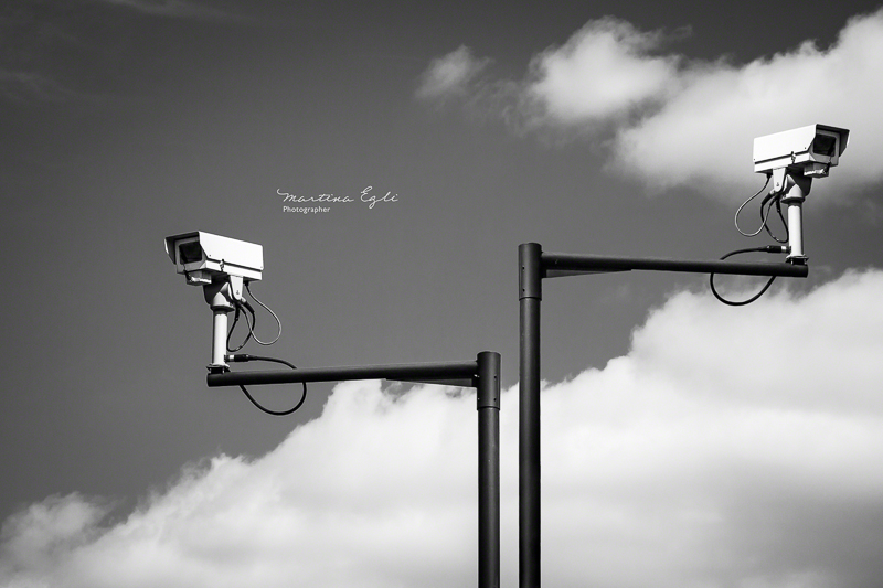 Two CCTV cameras in the streets of London.