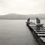 A jetty over Loch Lomond in storymy weather.