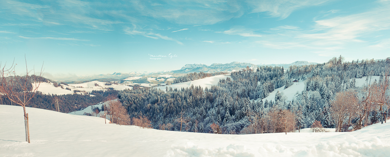 A view of a snowy landscape with mount Pilatus in Switzerland.