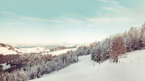 A view of a snowy landscape in Switzerland.